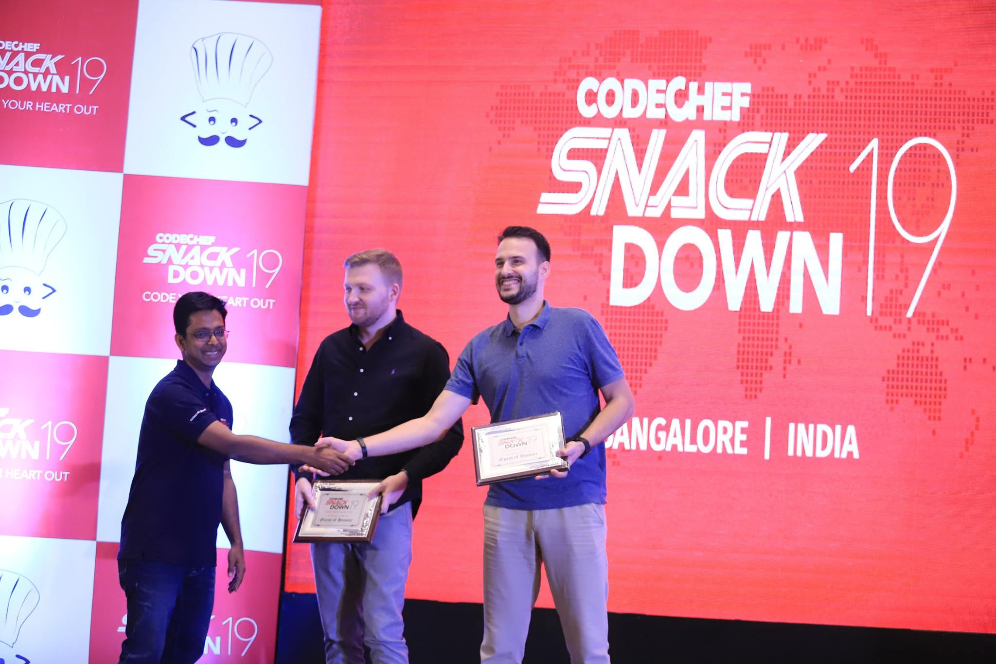 A picture of Sphere Engine staff members giving awards during a code challenge held in Bangalore, India